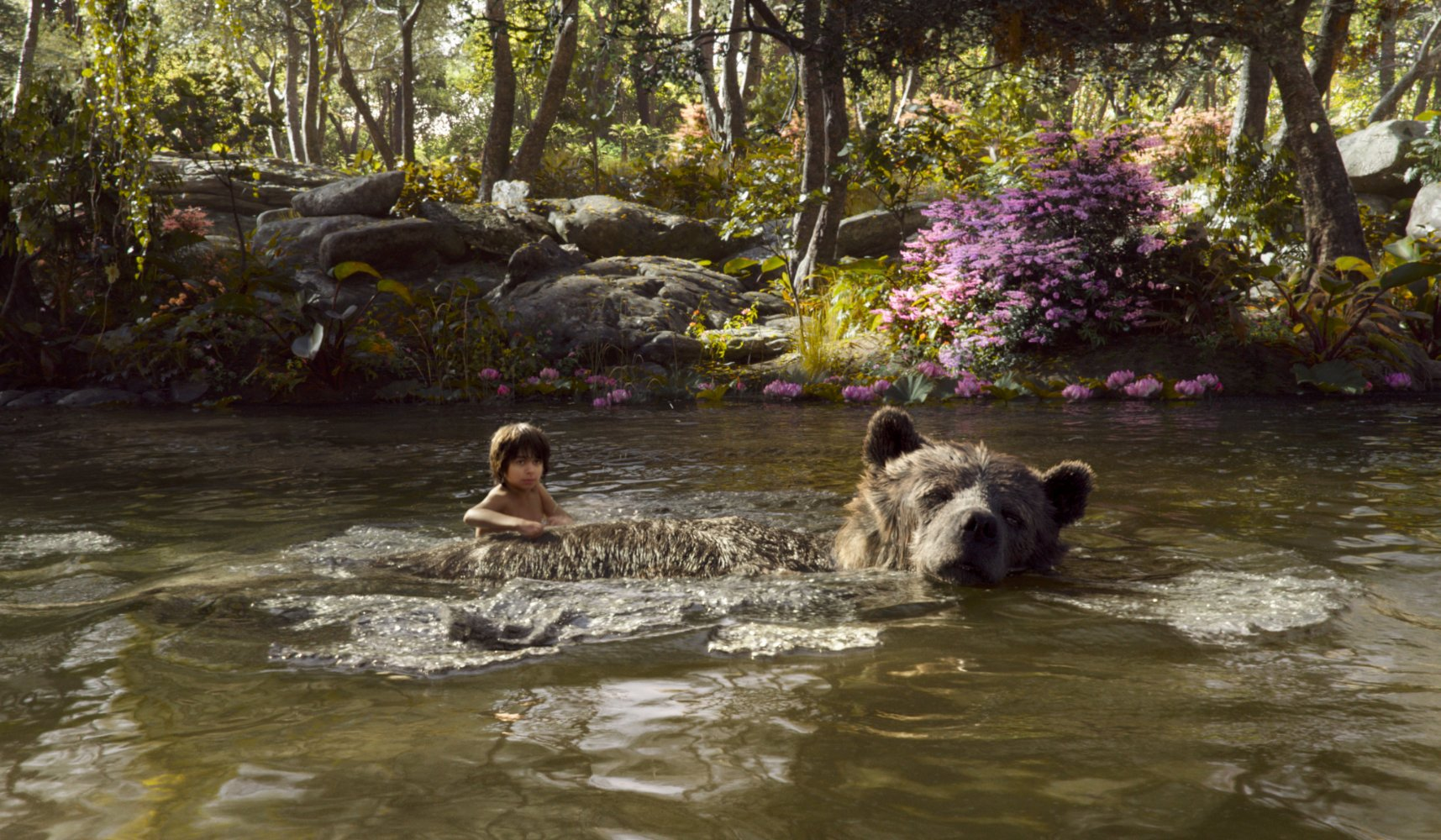 THE JUNGLE BOOK (Pictured) MOWGLI and BALOO. ©2016 Disney Enterprises, Inc. All Rights Reserved.