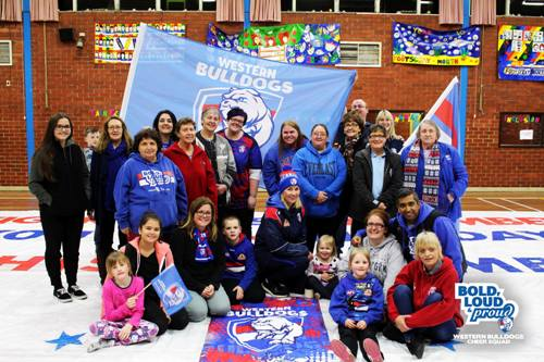 Members of the Western Bulldogs cheer squad at banner making