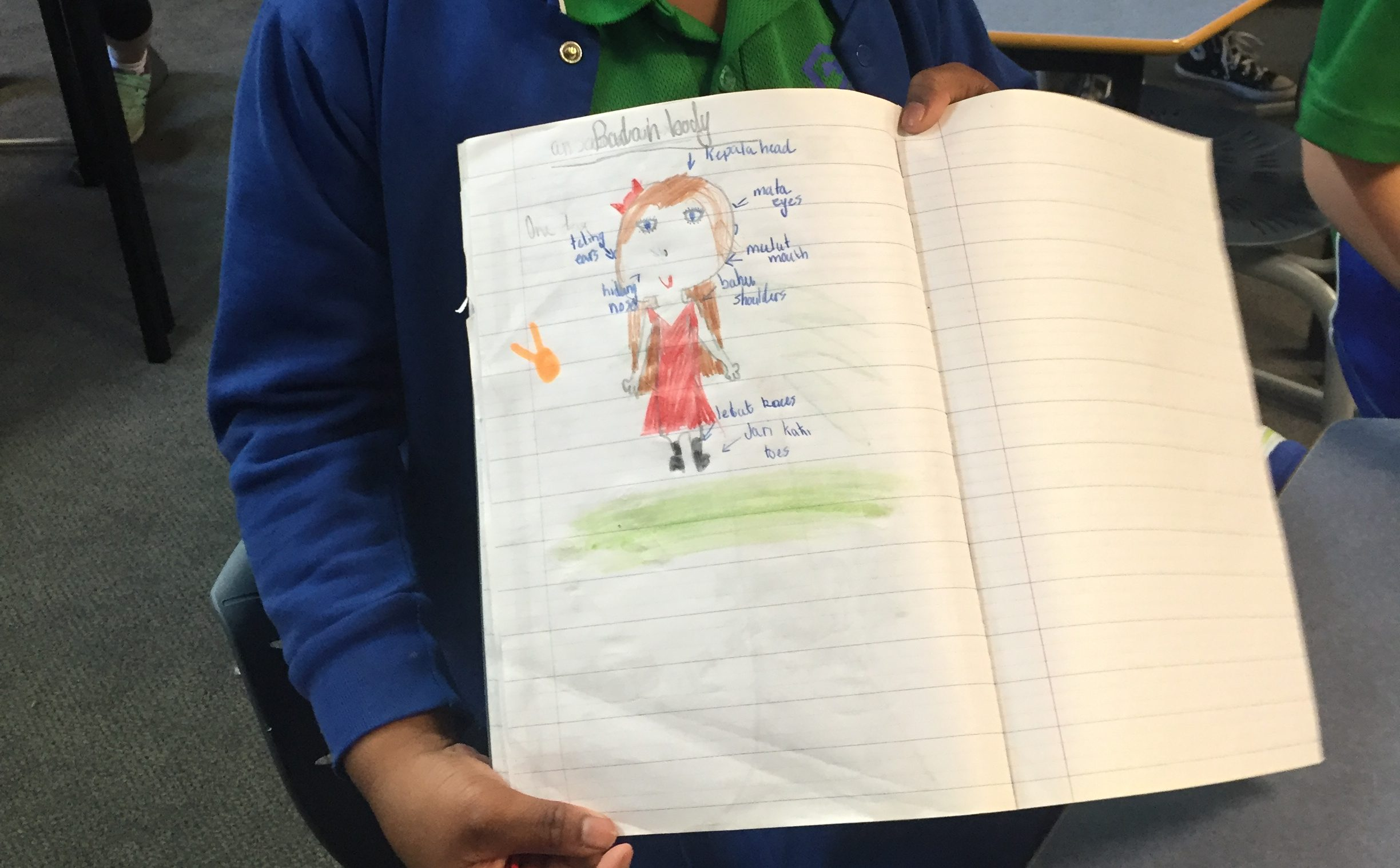 Grade 2 student with Indonesian workbook. Photo by Madeleine Neale.